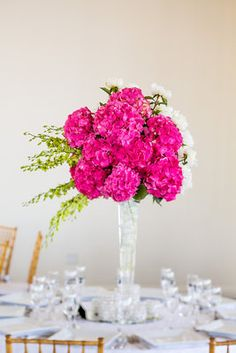 Burst of pink at in a gold and white reception space. Joshua Zuckerman Photography