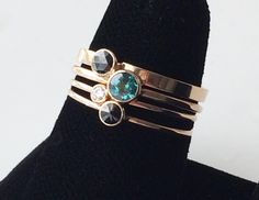 Gold stack of Black Diamonds, Baby White Diamond and Green Topaz rings.....