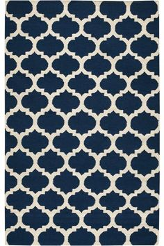 A trend that never gets old? Navy and white. This gorgeous trellis pattern would make a beautiful statement in a bedroom or family room.