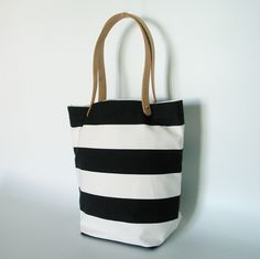 stripes and leather - I like the way the handles have been attached!