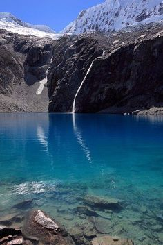 Brilliant blue lake in the Parque Nacional Huascarán, Cordillera Blanca, Peru. Places Around The World, Oh The Places You'll Go, Places To Travel, Places To Visit, Travel Sights, Travel Destinations, Machu Picchu, Peru Travel, National Parks