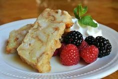 Menu Item: Bread Pudding with Croissants and Danishes baked in vanilla custard, served with brandy anglaise, fresh berries & whipped cream