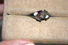 Garnet and opal goldwash ring-Unusual! size 6.5  Looks like goldwash over silver, the garnets are faceted, the opals are cabbed, and there are remains of vermiel in the laurels that make up the body of the ring. Ring is very well made with lots of small detail, stones are claw set, and ring is a size 6.5.  Laurel leaves - triumph. Peace   Ring is part of my personal collection, and is currently for sale!