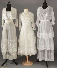 THREE WHITE COTTON TEA GOWNS, c. 1915 1 lawn w/ triple tier embroidered skirt & blouson top; 2 net: 1 w/ bodice & over-skirt in heavily embroidered roses & 1 trimmed in chemical & filet lace, 3 hem flounces