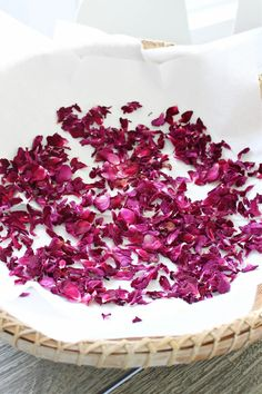 How to dry roses - click to see how to dry rose petals and find out rose petal uses for skin care. I'll show you how to turn these dried rose petals into a rose petal infused oil, the key ingredient in rose petal salve and rose petal lip balm. Make your own rose infused skin care products. How to air dry rose petals easily for DIY rose petal projects.
