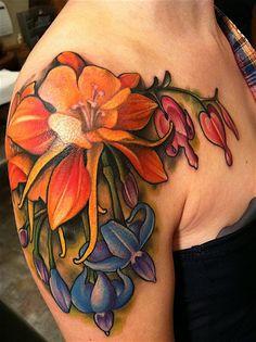 Gorgeous flower tattoo by Amanda Leadman. I love her work.