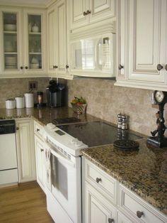 Cabinet color Alder distressed white..  Granite counters..  think thats on my list for kitchen..    Giallo Fiorito granite  Cabinet color