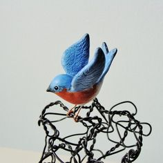 Tiny Bluebird -- Polymer Clay and Wire Sculpture. $46.00, via Etsy.