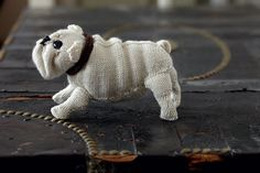 from the book Best in Show by Sally Muir and Jo Osborne- web link has free pattern to knit a Jack Russell Terrier
