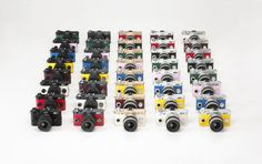 Kleinste DSLM weltweit: Pentax Q-S1 ab September in 40 Farben erhältlich.