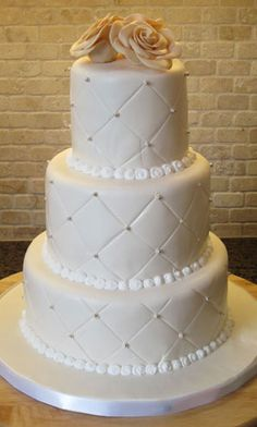 wedding cakes.. minus the top flowers and add color to pearl looking things.