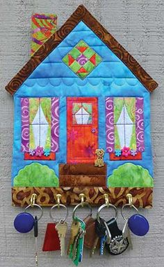 """This pattern is really a """"key""""-per! If you're always looking for your keys, this little quilted wall hanging will keep them right where you want them! It's"""
