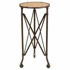 "Wood-topped end table with a metal frame and castered feet.      Product: End tableConstruction Material: Metal alloy and woodColor: BrownFeatures: Casters on legsDimensions: 31"" H x 14"" Diameter"