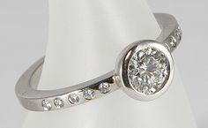 Cannikin Diamond, 18ct white gold, 18ct white gold cup, spilling over onto the shoulders. Shown here - centre diamond G/H VS, weight 0.61ct,...