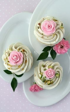 Rose Cupcakes with White Chocolate Swiss Meringue Buttercream and Pistachio bits (recipe).