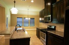 Kitchen, granite countertops, solid wood cabinets, stainless steal appliances, custom backsplash #mcbeehomes
