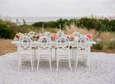 Intimate beachside wedding reception with gorgeous vintage table setting  #wilddunesweddings bit.ly/1ZuZSd7