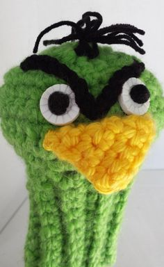 Look at the head on that driver! Betcha didnt know that Angry Birds are big golf fans. This eye-catching club cover will intrigue friends and foursomes alike, making you a real hit on the fairway. This fun and funky golf club cover will give everyone something to talk about...even if it isnt your swing.   This fierce Green Angry Bird, golf head cover provides great protection for your clubs. The club head cover features a long neck sock to provide extra club shaft protection. It is a…