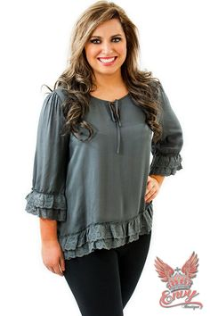 Ruffles and Lace Top - $34.95 - This Ruffles and Lace Top is sure to draw a few envious looks from your friends, with its cute front tie, to it ruffles of lace trim on the 3/4 sleeves and bottom hem.  | available at https://www.envyboutique.us/shop/ruffles-lace-top/ |  #Envy #Boutique #fashion #fashiontrends