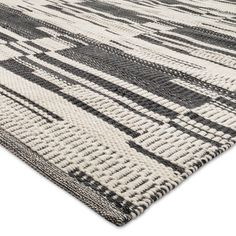 Stark contrasting colors add pop to the Geometric Area Rug from Threshold. This hand-woven throw rug can be placed front and center for impact or to ground a seating area.