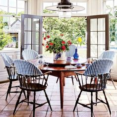 Isn't it funny how gingham works whenever & wherever? - From my design files of lovely rooms, this sunny breakfast room by Mark Cunningham Inc is the essence of easy-breezy summer! Fresh flowers, doors flung open, sunshine and music playing...Happy Wednesday! 📷 via @archdigest