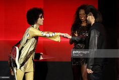 <a gi-track='captionPersonalityLinkClicked' href='/galleries/personality/203048' ng-click='$event.stopPropagation()'>Prince</a> gives <a gi-track='captionPersonalityLinkClicked' href='/galleries/personality/8008743' ng-click='$event.stopPropagation()'>The Weeknd</a> an award onstage at the 2015 American Music Awards at Microsoft Theater on November 22, 2015 in Los Angeles, California.