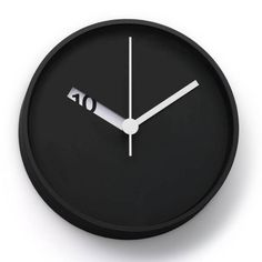 The Extra Normal Wall Clock has an extra clever design, with laser cut openings subtly revealing the time.