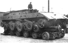 Panzerkampfwagen E-100, (Gerät 383) (TG-01) was a German prototype of the Entwicklung Series super-heavy tank designs near the end of World War II. The E-100 was to be designed to be the replacement for the prototype-only, Porsche-designed Maus. British forces captured the prototype in 1945, shown here on a trailer.