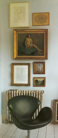 swan chair and old world art wall