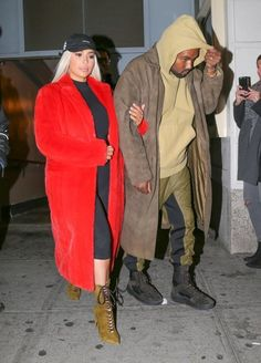 Kim Kardashian Photos Photos - Reality star Kim Kardashian and rapper Kanye West were seen leaving 'Hamilton' the musical on Broadway in New York City, New York on February 12, 2016.  Kim wore a platinum blonde wig, which create a stark contrast against her red coat. Kanye has stirred the pot yet again with Taylor Swift and now her entourage of friends are backlashing against the rapper. - Kim Kardashian