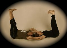 a couple does a yoga poses that uses core strength