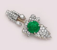 Carved emerald, marquise-cut diamond, diamond and platinum jabot brooch. Cartier.