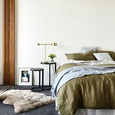 Bedroom interior of 13th Beach at Barwon Heads, showcasing the versatility of the Nest Side Tables by Adam Goodrum for the AGxCult Collection. Design by @auhaus, styling by @nina_provan and photography by @derek_swalwell.  #cultholidayedit #adamgoodrum #agxcult #cultdesign #nesttable #interiordesign #australiandesign #sidetable #bedroomdesign #bedroomstyle #moss #timber #concrete #ninaprovan #auhaus
