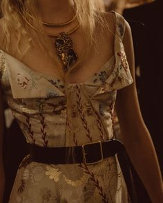 The bodice of the heritage patchwork jacquard dress from AW17 is corseted and finished with featherstitch embroidery.