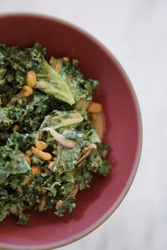 kale salad from M cafe in LA: Salad: 1 large bunch kale ¼ cup peanuts, chopped for garnish ¼ red onion, halved and sliced for garnish Spicy Peanut Dressing: ½ cup peanut butter 1 ½ T honey 2 T low sodium soy sauce 2 T brown rice vinegar ½ tsp. garlic, minced ½ tsp. ginger, minced ¼ tsp. cayenne pepper 1/8 tsp. salt 1 ½ oz hot water
