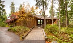 """An entrance that pulls you inside~ """"The exterior is constructed of Schubart's characteristic random-width cedar siding. Even the garage doors are disguised behind a random-width veneer, which was applied after construction."""" –Houses Made of Wood and Light, by Michele Dunkerley, p. 97"""