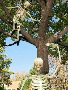 Playful Leaf-Jumping Skeletons  http://www.bhg.com/halloween/decorating/outdoor-halloween-decorating-skeletons/#page=3