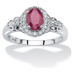 PalmBeach Jewelry 1.18 TCW Oval Genuine Ruby and Topaz Halo Ring in... (255 BRL) ❤ liked on Polyvore featuring jewelry, rings, jewelry & watches, oval ring, ruby cocktail ring, sterling silver topaz ring, oval cut ring and cocktail rings