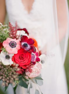 red anemone and rose bouquet - photo by Emily Katharine Photography http://ruffledblog.com/relaxed-brunch-wedding-in-florida
