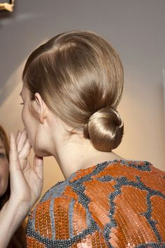 i love this low bun. i'm growing my hair out basically for this reason.