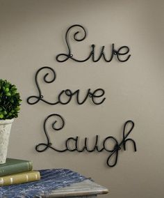 All of our Metal Wall Words are made of tubular black metal with a black powder coat finish, Each word has black circle hangers cleverly designed into the lettering and easily mount to the wall with 2 nails or screws, no need for wall achors