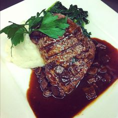 6oz Grilled Top Sirloin with Goat Cheese Mashed Potatoes and Sautéed Spinach with Cabernet and Nueske's Bacon Veal Reduction