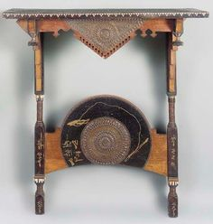 AN INLAID WOOD CONSOLE TABLE  BY CARLO BUGATTI, ebonised and varnished wood applied with copper roundels, bone and inlaid in pewter, 34½in. (88cm.) width   |  SOLD $9,588 Christie's London, April 21, 2004