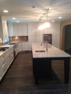 our team increased cabinet and counter space with new cabinets counters and a beautiful 12 foot long island  total transformation with new floors     what u0027s not to love about this new 12 foot kitchen island from a      rh   pinterest com