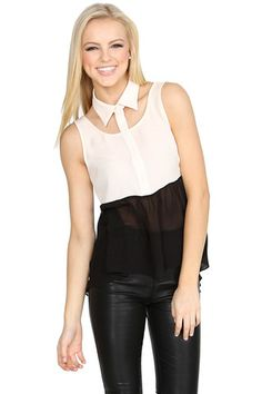 TUXEDO GIRL TOP by Sugarlips – BKLN A half cream half black chiffon sleeveless top that features cutouts around the top to accentuate the neck. Back features a deep V neck and high low hem. Pair it with black trousers, patent oxfords and a bowler hat for a cool androgynous look.