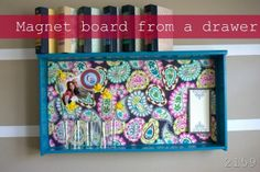 Drawer repurposed into a magnet board.