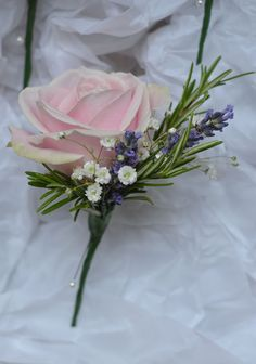 Buttonhole of rose, lavender, gyp and rosemary