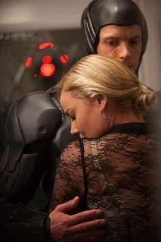 Abbie Cornish as Ellen Murphy & Joel Kinnaman as Alex Murphy - RoboCop