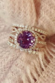 engagement ring trends purple centerstone rose gold round cut pave bands