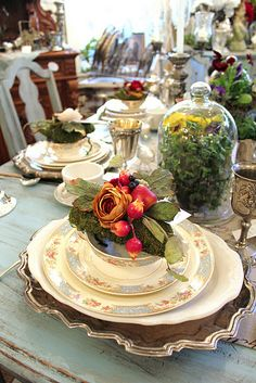 Gorgeous tablesetting with individual arrangements. I love the idea of guests taking something beautiful home with them. This would be nice for a special ladies get-together.